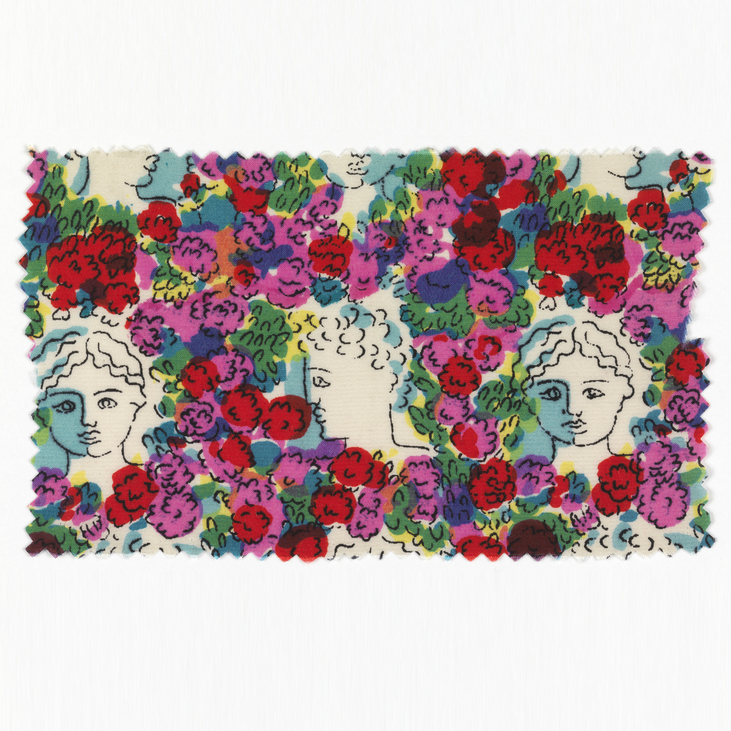 White ground with clusters of multicolor flowers and classically-inspired portrait busts with blue highlights.