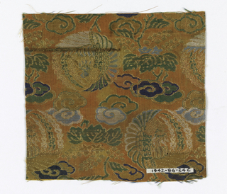 Orange ground. Phoenix in medallions, clouds, and maple trees in gold, blues, green, beige, and white.
