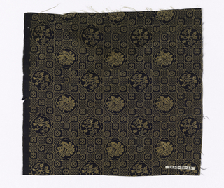 Black ground with gold grid pattern, medallions with flowers and butterflies