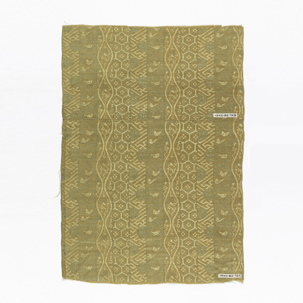 Beige ground with green patterning in vertical bands with motifs of mountains, hexagons and waves.