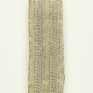 Strip of very sheer, loosely woven undyed plain weave cotton with small-scale design of hatched stripe in gold leaf alternating with stripe with central black line with pairs of small leaves drawn in black and painted pale lavender springing on either side of gold dots close-set on the central line.