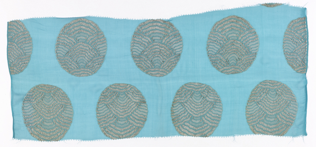 Medium blue georgette crepe with large circular medallions brocaded in grey silk.