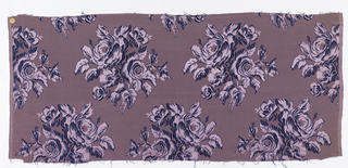 Woven silk textile showing purple roses.