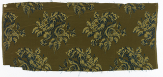 Woven silk textile showing yellow roses on a green ground.