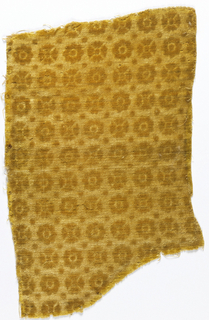Close-set repeat of small stylized rosettes alternating with dots, in gold-colored wool velvet. Motifs in relief on pressed ground of same.