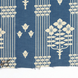 Printed blue and white textile showing stylized flowers growing in sprigs of three, interspaced with vertical lines and scattered buds, all forming a grid effect.