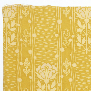 Printed cotton textile showing pattern of white roses and leaves between wavering vertical stripes on yellow ground.