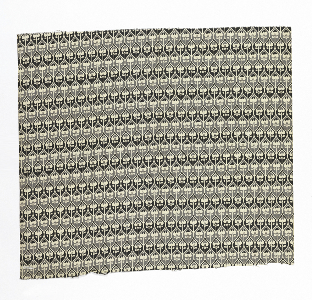 In light and dark grey, and white, small-scale all-over pattern of dove-tailing ogives containing palmette.