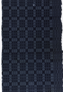 """Large geometric pattern in square framework suggesting """"Lover's Knot."""" In dark blue wool floats on a lighter blue linen ground; possibly a natural linen ground dyed at a later date."""