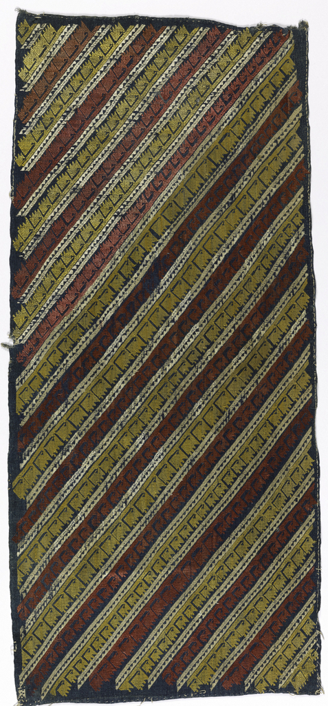 Coarse blue linen tabby embroidered with saw-tooth bands of white separating diagonal rows of red and yellow running stitch which reserve rows of backward L-shaped forms.