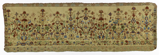 Narrow panel, possibly part of a curtain, in dark natural linen, sheer plain weave, embroidered in polychrome silks in blue, red, violet, yellow, light blue and white, with blue and red predominating. Central motif of a palmette with sprays springing from top and sides, flowers and heavy leaf. Narrow border at one end.