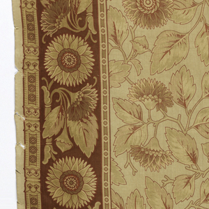 Fabric printed with floral patterns in a field and side border, to be used as a hanging or bed cover, in reds and yellows, now faded. The floral patterns of the field and border are designed to be seen from either end, making it easy to join two lengths, one turned 180 degrees, to make a large field with a border on left and right.