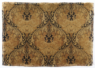 Fragment of printed cotton textile in shades of yellow and dark brown showing repeating ogee pattern composed of conventionalized flowering plants.