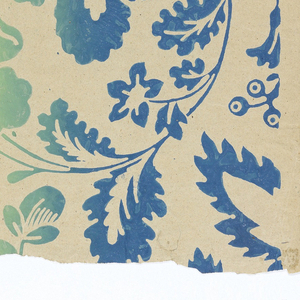 Irise or rainbow paper. Full width of paper giving repeat of large-scale arabesque of flowers and foliage in graded color, ranging from blue along edges to green down center.