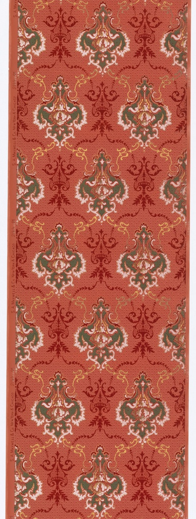Floral medallions, connected by foliate swags. Printed in green, burgundy, white and metallic gold on red ground.