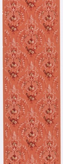 Floral bouquet set within scrolling foliate medallion. Medallions are connected by floral swags. Printed in white, red and green on pink ground.