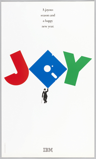 On a white ground, bordered by gray frame, the word: JOY. J is red, O is blue in the shape of a floppy disk, and Y is green. The floppy disk is balanced on the hand of a Charlie Chaplin figure in black. Above, in black ink: A joyous / season and / a happy / new year. Lower margin, in black: IBM [logo].