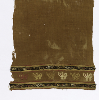 Vertical strip of brown cotton cloth brocaded with pumas in tan, white and red cotton; crossed at intervals with narrow horizontal bands with bird repeats and stripes in red, white, and dark brown. Same warps grouped by 3s used for these bands. Selvages on vertical sides. Some areas of plain weave.