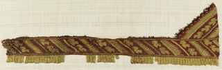 Border strip with flat tapestry woven fringe. Slanting bands of stylized bird motifs. Tan on red background.