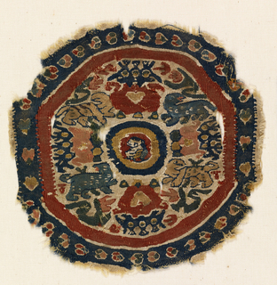 Woven Coptic roundel showing concentric circles with an animal head at center; pairs of animals crowned by a three-headed bird with a heart on its breast. Soumak used for outlines. One weft carried at a time.
