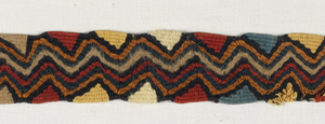 Fragment of a tapestry-woven band with varied zigzag stripe and diamond patterns, in red, yellow, green, black and tan.