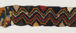 Two fragments of headbands in tapestry weave.  Red, yellow, green, black and tan.  Part of design has narrow zigzag stripes.