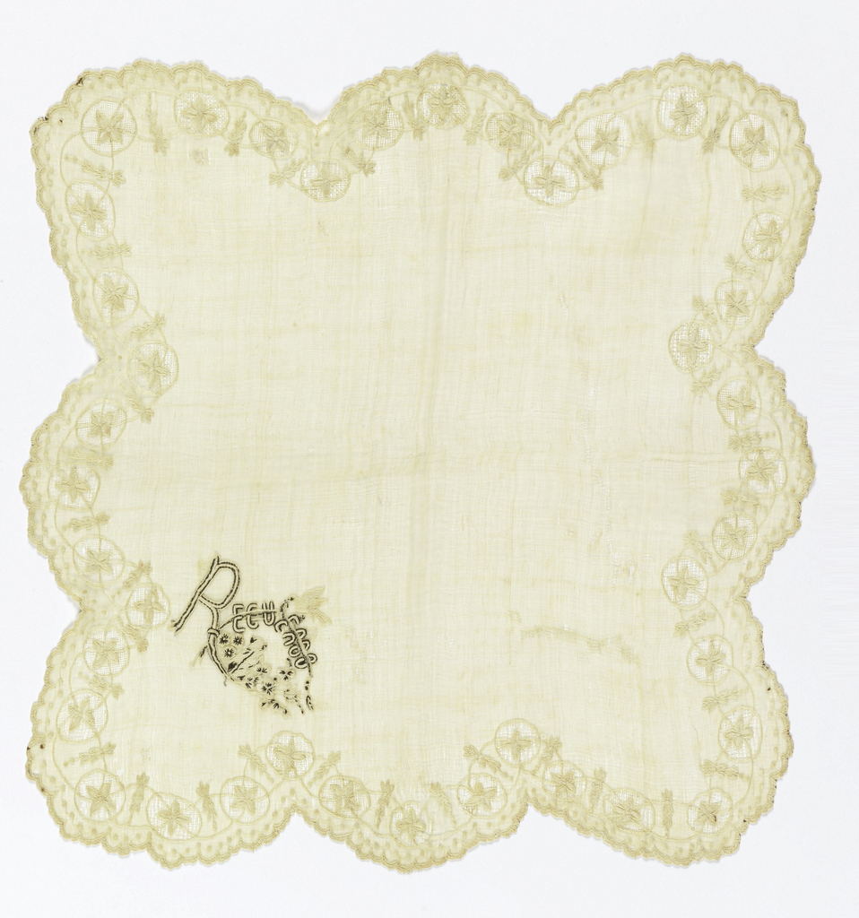 "Handkerchief in piña cloth with scalloped edge, buttonholed and with border of flowering vine, embroidered in cotton, crossing circles of drawnwork. Corner in black and white with word: ""Recuerdo"" with bird above and small dog or cat below flowers."
