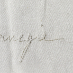 Damask tablecloth with embroidered signatures of the guests in the position they sat at the table, including Ignace Jan Paderewski and dated 1896.