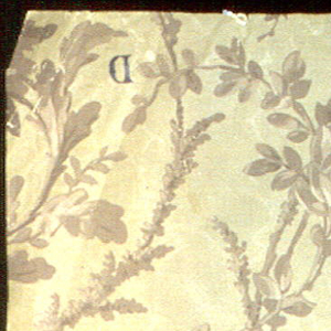 On khaki-colored horizontally-ribbed paper with moire finish, brown foliage forming scroll patterns which end in roses.