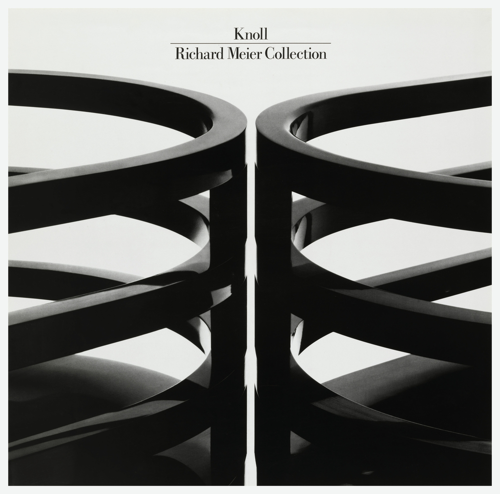 Two rounded black chairs with backs composed of what seem like 3 stacked rings held together by a vertical bar. The chairs are back to back and cropped so that only the backs are visible. Above, in black: Knoll / Richard Meier Collection.  An example of the chair is featured in the collection of Cooper-Hewitt (1990-139-3).