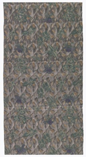 Dense pattern of flowers in greys and greens, highlighted with printing and embroidery which hangs of the surface in tassels.