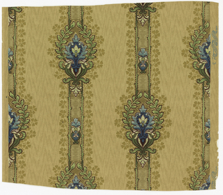 "Vertical stripings (3 to a width) of symmetrical foliage and scrollwork in green and blue, outlined in maroon. Stripings bordered by beige ""clover"" springing from continuous vine. All-over imitation wood grain."