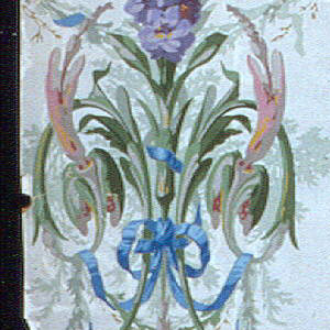 On white imitation moire silk, symmetrical clusters of purple and pink flowers joined by swags with twisted blue ribbons.