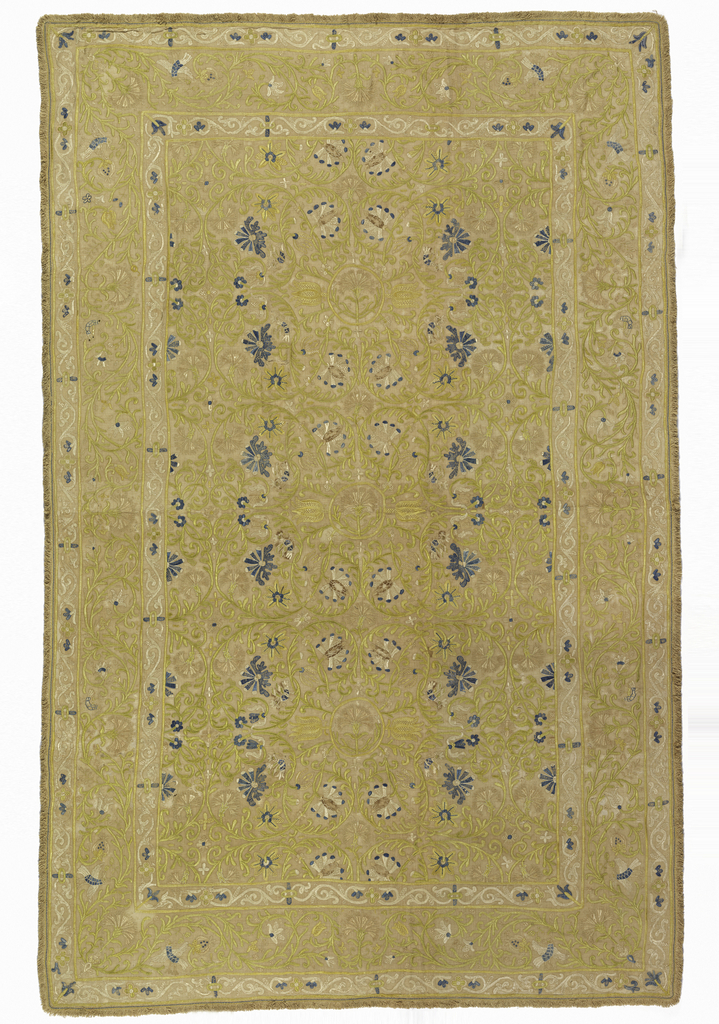 Large bedcover of cream-colored linen embroidered in light yellow, yellow-green, blue, rose and white silk. The design is laid out in a central panel with a narrow border at the edge. Central panel has a design in natural scale of symmetrically arranged curving vines ending with flower heads, carnations, tulips, and lilies with occasional birds in the foliage. Borders have a vine pattern.