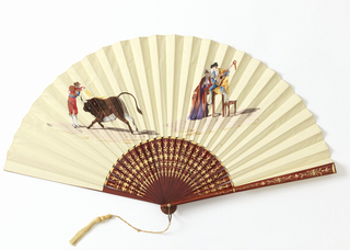 Pleated fan painted on obverse with a scene of bullfighting on the left, and a woman in a manton de Manila next to a torero playing the guitar on the right. Reverse: blank. Sticks varnished red and gilded. Silk tassel.