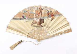 Pleated fan painted with a bull fighting scene showing a man leaping over a bull on a pole. The reverse has a man and two women in conversation. Sticks are mother-of-pearl carved à jour. Paste head on pin. White cord and tassel.