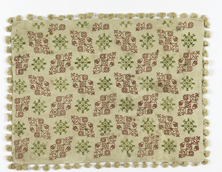 Oblong pillow cover of heavy cream-colored linen embroidered in red and cream silk, ornamented on four sides with small tassels of cream linen with a few threads of red and green silk. Fastened at one side with five pairs of trim linen cords. Design arranged in rows of stylized, detailed plant forms and geometric shapes. Elements staggered in parallel rows.