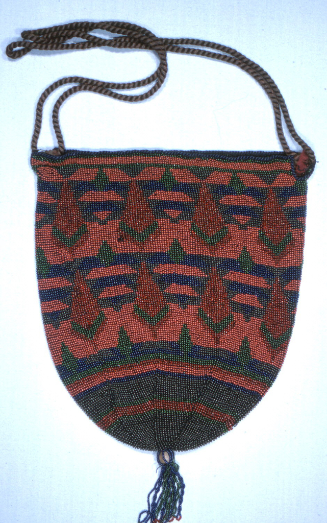 Pouch shaped bag drawn together at bottom with a tassel; rope handle of brown silk cording. Two rows of repeat pattern of tree-like geometric shapes, worked in dark shades of red, blue, green and gunmetal.