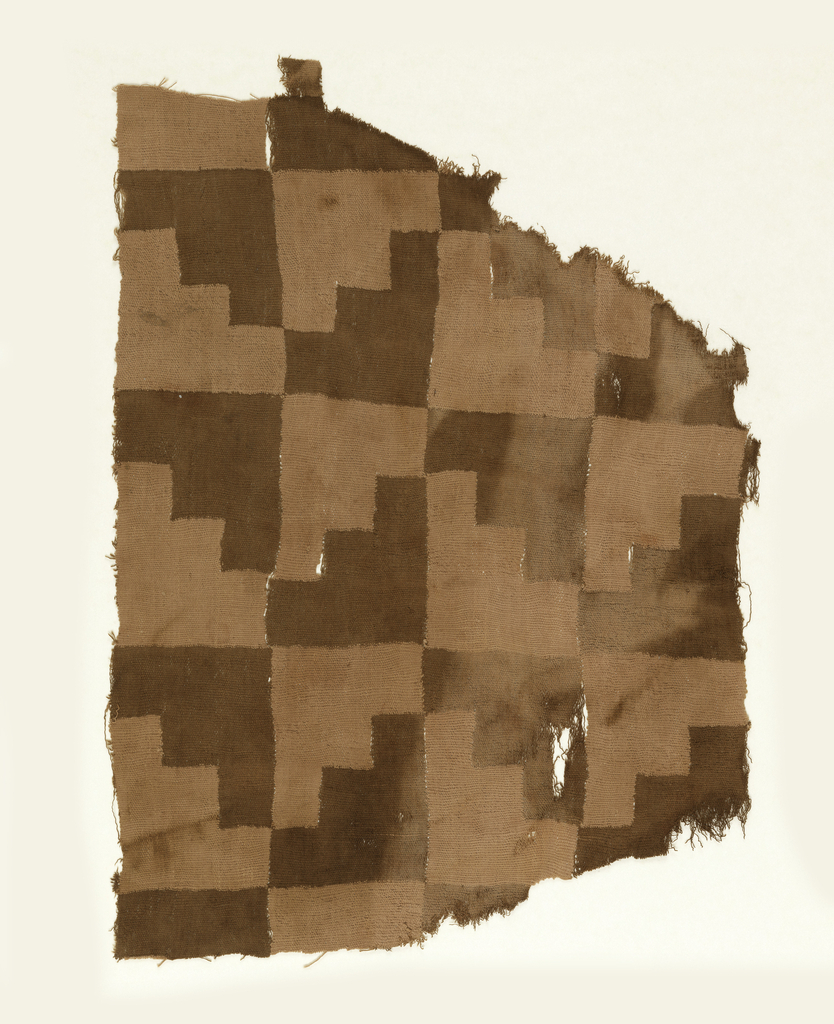 Fragment of a woven tunic with interlocked step patterns in brown and pink.