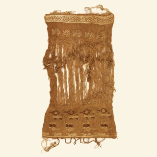The fragment has woven parts from sides with bird motifs in brown and light tan on a tan background. The center part shows the warp. Two loom sticks are attached. Fragment was found in Chillon Valley, near Hasierida San Miguel de Chocas. (b and c are 2 loom sticks)