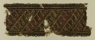 Band of brown wool with diagonally placed design in red, yellow and lighter browns.