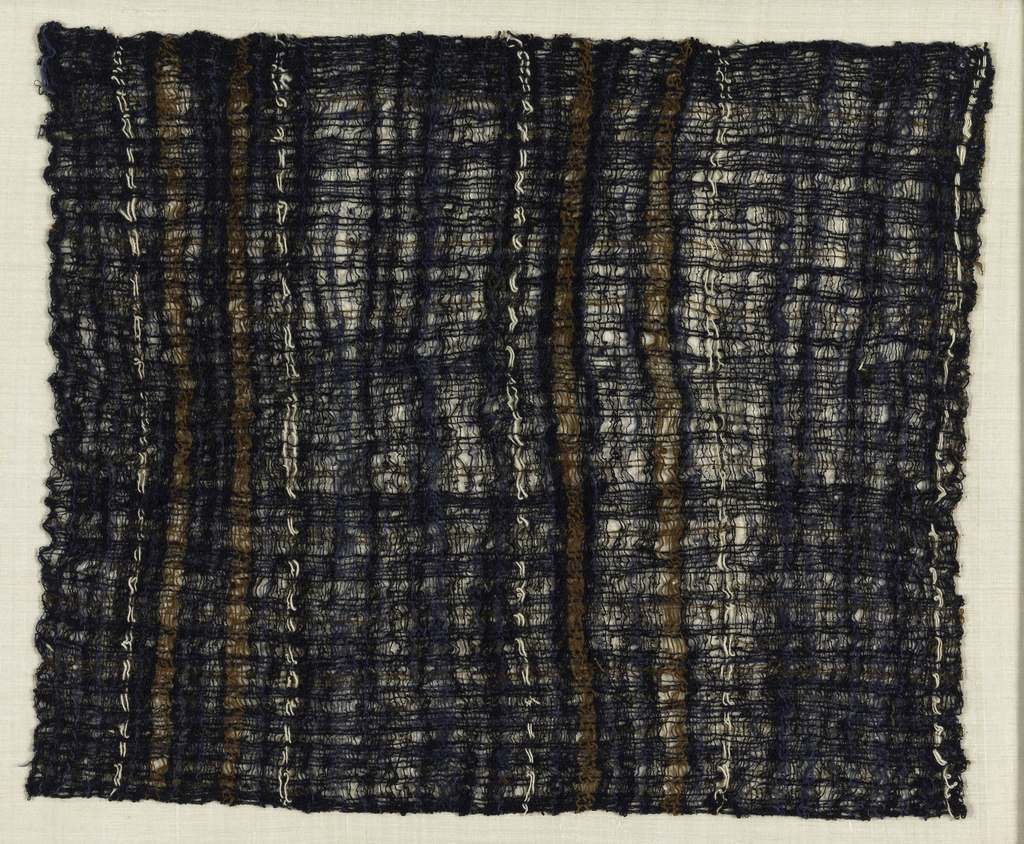 Carrying cloth of loosely woven, crepe-spun, indigo-dyed cotton, with stripes of brown and natural off-white cotton.