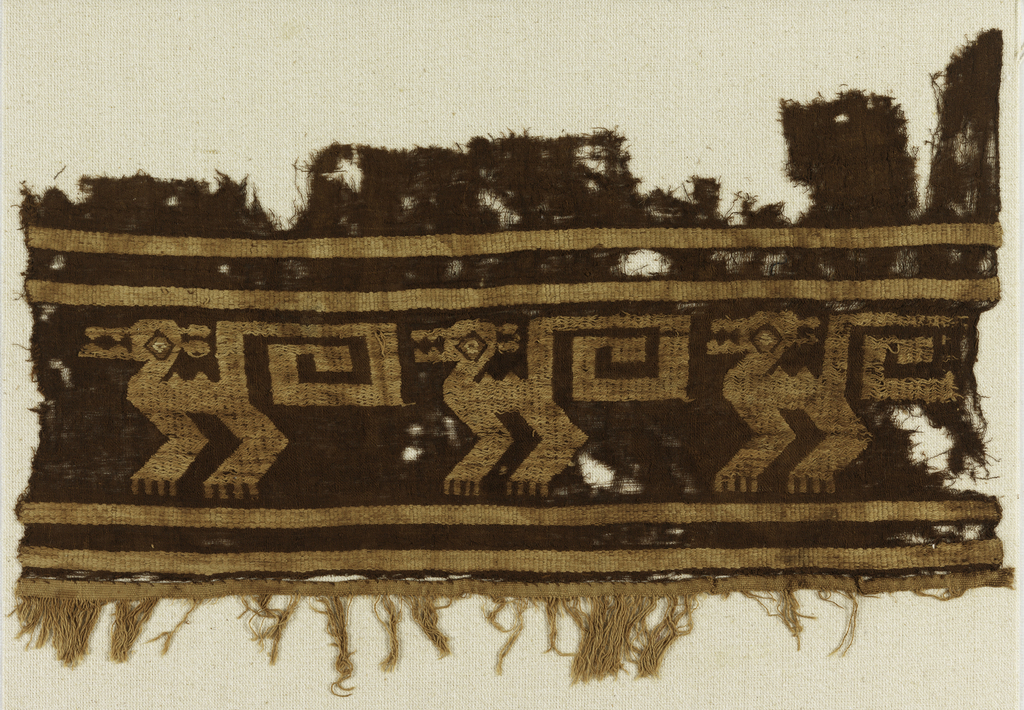 Fragment of a border with highly conventionalized birds in tan. Fringes at the bottom.