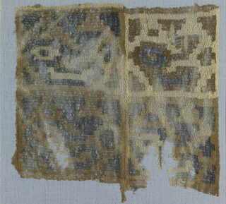 Square panel made from two pieces stitched together. Panel is divided into four squares with a single repeat of a large stylized bird with elaborate topknot and small geometrical filling forms in each. In combinations of blue, brown and natural cotton. Series of regularly spaced weft knot warps form long triangular mesh.