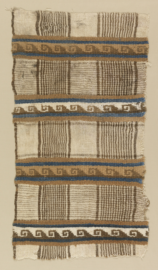 Tabby weave with crossing bands of double-faced weft patterning. Brown and white plaid effect crossed at intervals by narrow brown ribbed bands with blue continuous scroll.