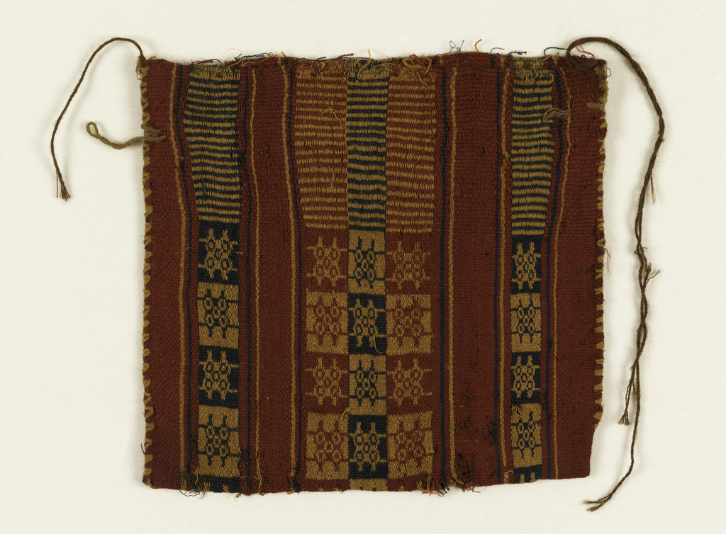 Flat bag woven in red stripes, alternately decorated in geometric pattern, similar to a game board.