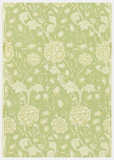 "The design consists of two floral motifs. One is suggestive of a large double poppy and the other a lily-like flower. There is also a continuous winding stem with poppy leaves running through the design. Poppy leaves, stems and background are pin-pointed. ""Morris & Co."" printed on margin. Printed in ivory and gold on green field."