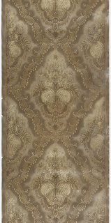 Roll of embossed damask pattern wallpaper in brown and gold.