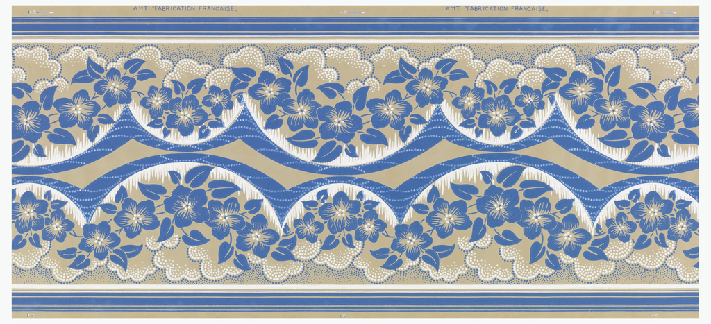 Printed two across; blue roses with brown leaves printed on geometric background, small floral band across the top of each border, gold highlights.