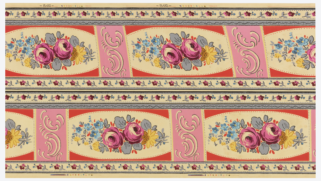"Floral border printed two across. Pink roses with other blue and yellow flower, in framework of pink with pink beading. Pink rectangle with scrolls separates floral motifs. Small floral band along either edge. Printed in selvedge: ""15410""."